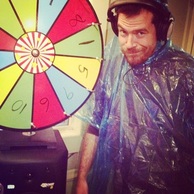 MattyF in his poncho after spinning the wheel of fate! Call us at 1(208)258-2072 or visit us online at radioboise.us to show your support for Tennis Court Disco!