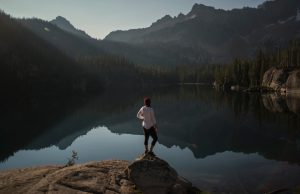 High Mountain Lake with a woman standing on a rock